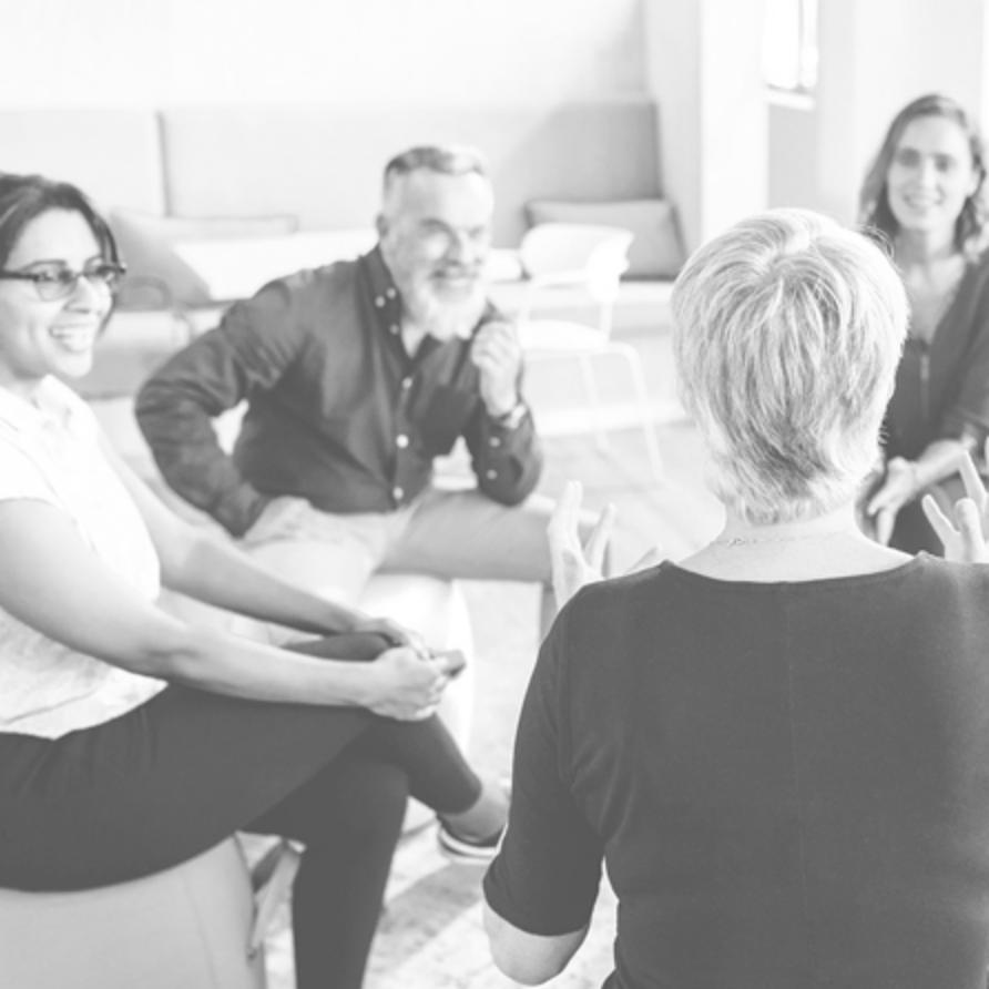 Fragrance oils team sat in a meeting